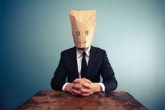 relaxed-businessman-bag-over-head-37556495