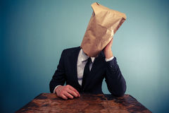 sad-businessman-bag-over-his-head-37556904